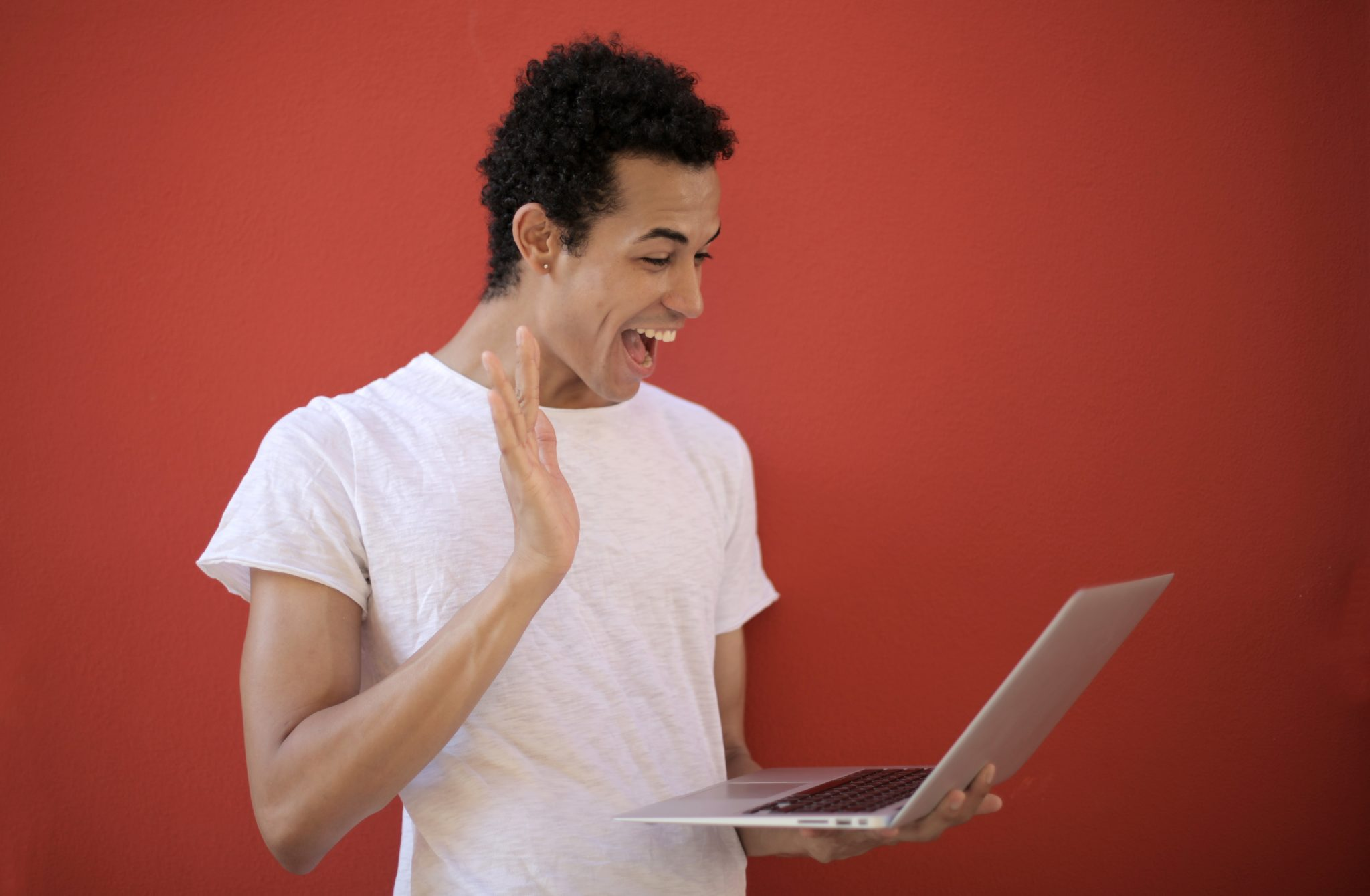 cheerful-man-using-laptop-for-video-call-3799821-2048x1340
